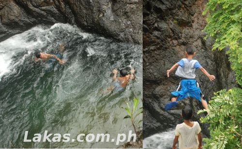 Locals jumping to one of the basin of the cascading falls