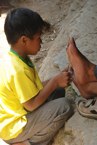 Foot Massage at Bomod-Ok Falls at Sagada, Mountain Province