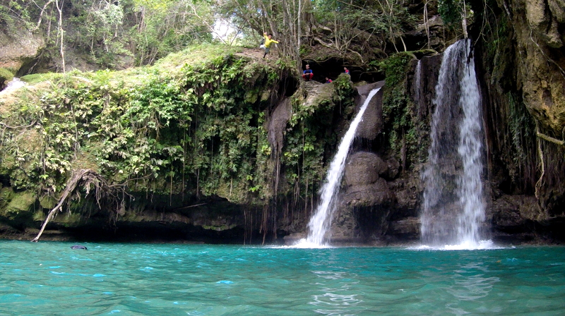 Kuya Jonjon doing a cliff dive on the second level of Kawasan Falls