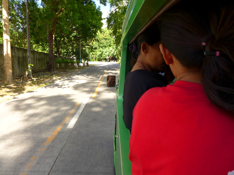 Inside the jeep to the Public Market of Badian