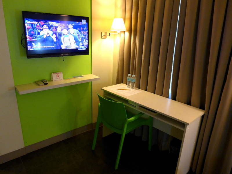 Table and TV at Pillows Hotel in Cebu City, Philippines