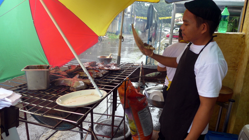 They keep on grilling even when it was raining hard.