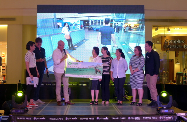 Pacsafe Co-Founder giving the donation to the Pawikan Conservation Center in Morong, Bataan
